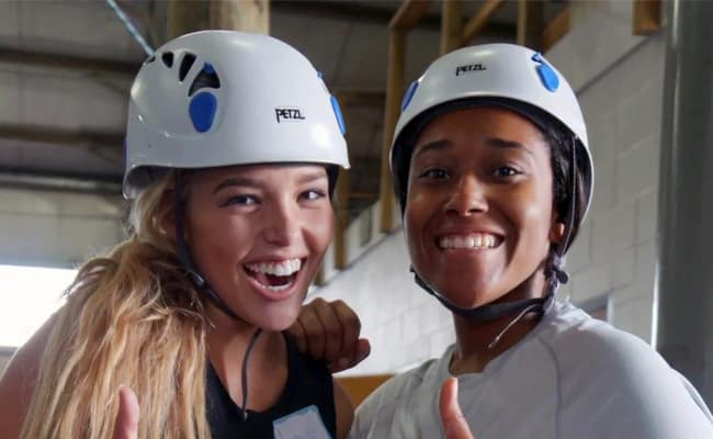 two young girls with helmets on