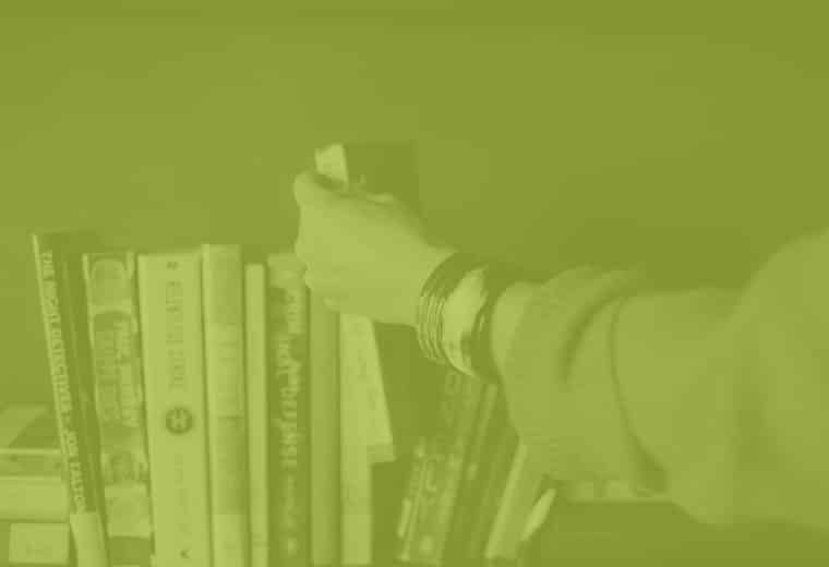 arm grabbing books